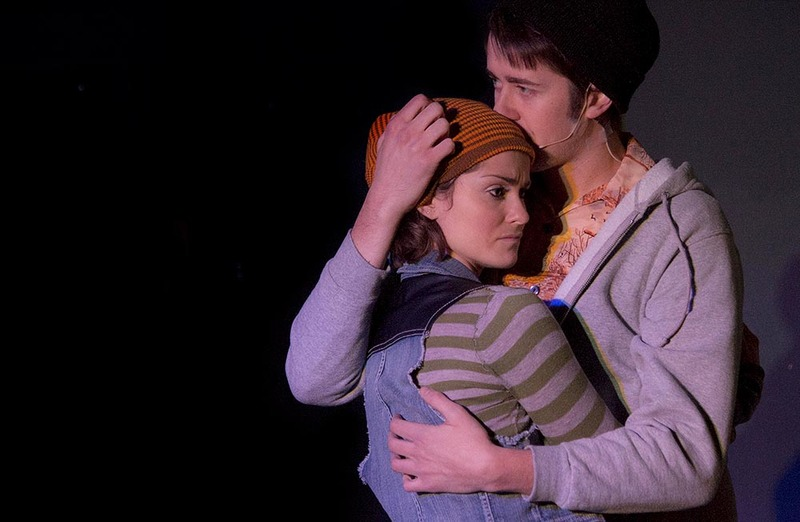 """(From Left) Natalie, played by Kate Metroka, hugs her boyfriend Henry, played by Tim Murray, at the Red House's production of """"Next To Normal."""" Courtesy of Jessie Dobrzynski"""